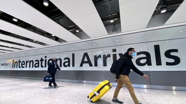 FILE PHOTO: Travellers at Heathrow Airport