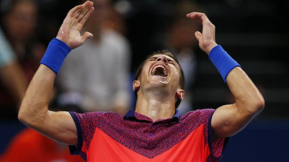 REFILE - CLARIFYING NATIONALITY OF NADAL  Borna Coric of Croatia reacts after winning his match against Spain's Rafael Nadal at the Swiss Indoors ATP tennis tournament in Basel October 24, 2014.   REUTERS/Arnd Wiegmann (SWITZERLAND - Tags: SPORT TENNIS TP