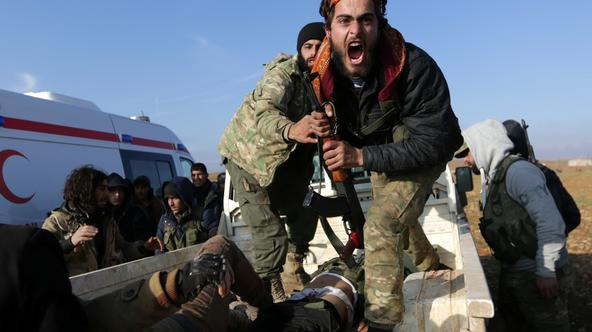 A Free Syrian Army (FSA) fighter reacts as he mourns near the body of his brother, who was an FSA fighter and died during an offensive against Islamic State fighters to take control of Qabasin town, on the outskirts of the northern Syrian town of al-Bab,