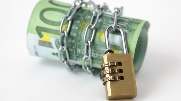 'Euro banknote with padlock and chain'