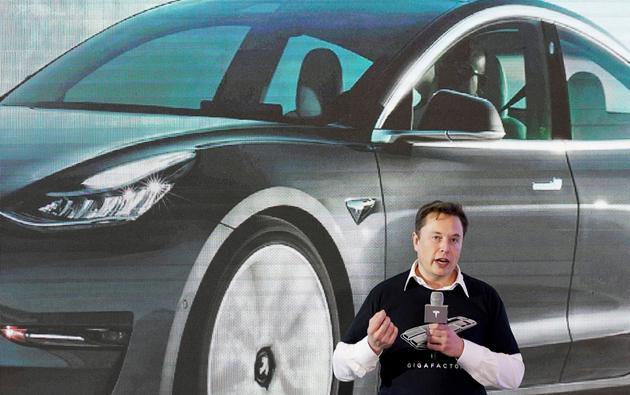 FILE PHOTO: FILE PHOTO: Tesla Inc CEO Elon Musk speaks onstage during a delivery event for Tesla China-made Model 3 cars at its factory in Shanghai