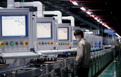 An employee works on the production line of electric vehicle (EV) battery manufacturer Octillion in Hefei