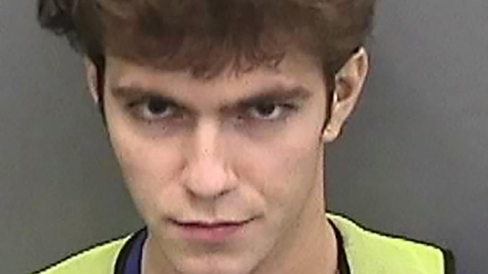 Graham Ivan Clark, 17, poses for a booking photo at Hillsborough County Jail in Tampa