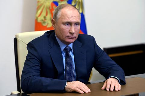FILE PHOTO: Russian President Vladimir Putin takes part in a video conference at the Novo-Ogaryovo state residence outside Moscow