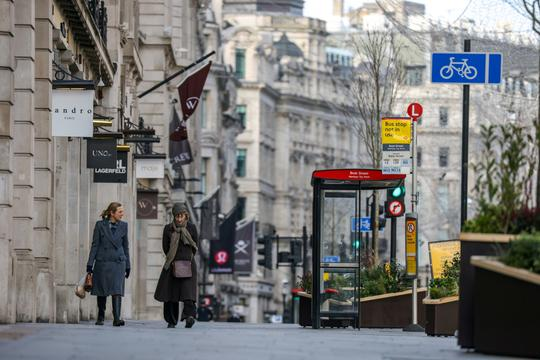 FILE PHOTO: Two women walk down Regent Street in London