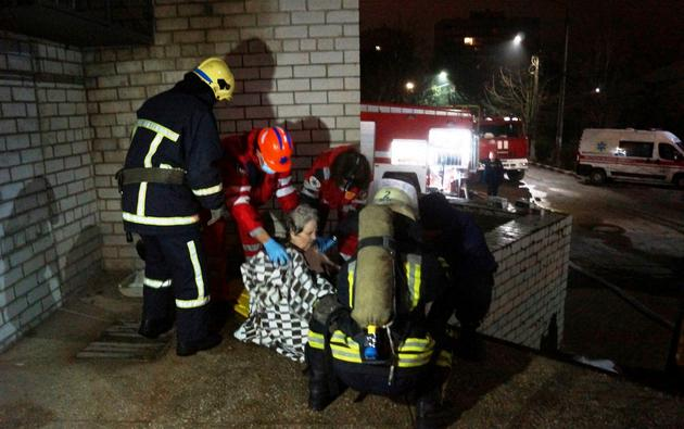 Rescuers and medics evacuate a patient after a fire at a hospital in Zaporizhzhia