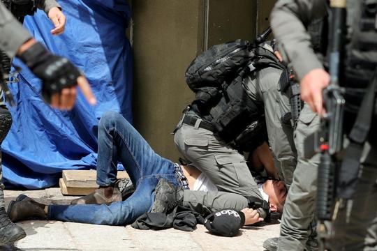 Israeli police clash with Palestinians at the compound that houses Al-Aqsa Mosque in Jerusalem