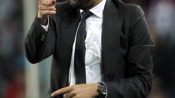 'Barcelona's coach Pep Guardiola gestures during their Spanish First division soccer league match against Mallorca at Camp Nou stadium in Barcelona October 29, 2011. REUTERS/Albert Gea (SPAIN - Tags: