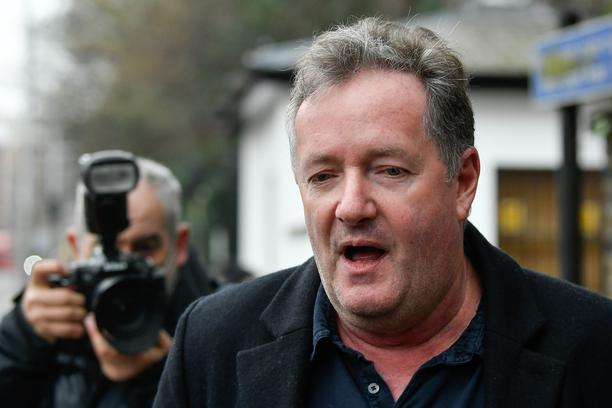 Piers Morgan walks with his daughter Elise in London