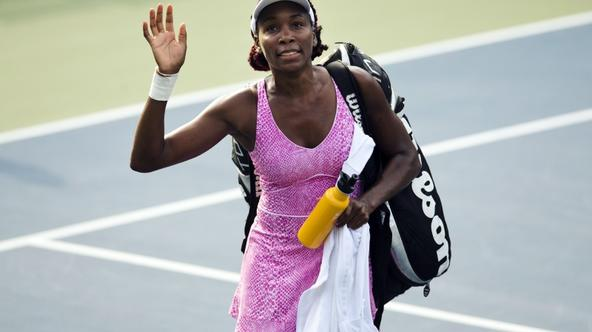 'Venus Williams of the U.S. leaves the court after being defeated by Kirsten Flipkens of Belgium during their women's tennis match at the Rogers Cup tennis tournament in Toronto August 6, 2013.    RE