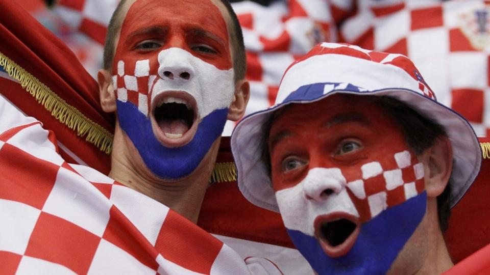 'Supporters from Croatia cheer their team before the game against Algeria at the Men\'s Handball World Championship  in Lund January 16, 2011.     REUTERS/Yves Herman (SWEDEN  - Tags: SPORT HANDBALL)