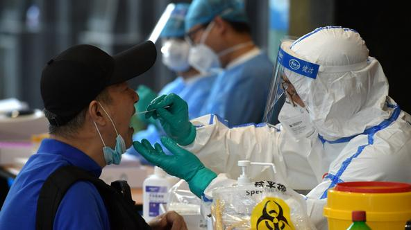 Medical staff collects swabs from people who have recently travelled to Beijing for nucleic acid tests, in Nanjing