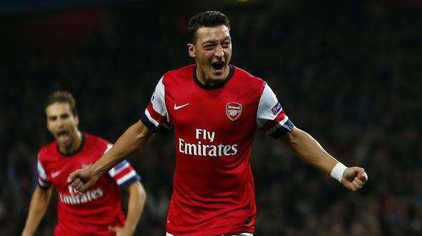 'Arsenal\'s Mesut Ozil celebrates after scoring a goal against Napoli during their Champions League soccer match at the Emirates stadium in London October 1, 2013. REUTERS/Eddie Keogh   (BRITAIN - Tag