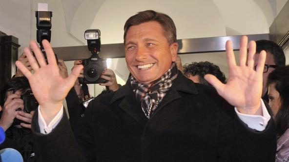 'Former prime minister Borut Pahor celebrates his victory with supporters after the unofficial results were announced in the second round of Presidential elections in Ljubljana December 2, 2012. REUTE