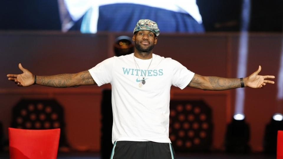 'Miami Heat player LeBron James reacts during a celebration of the Heat\'s 2013 NBA basketball championship at the American Airlines Arena in Miami, Florida June 24, 2013.  REUTERS/Joe Skipper   (UNIT