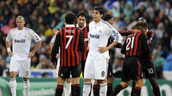 'Real Madrid\'s Brazilian midfielder Kaka (C) looks dejected as A.C. Milan\'s players celebrate the goal of A.C. Milan\'s midfielder Andrea Pirlo during the UEFA Champions League football match betwee