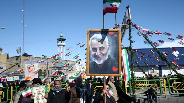 FILE PHOTO: An Iranian man holds a picture of the late Iran's Quds Force top commander Qassem Soleimani, during the commemoration of the 41st anniversary of the Islamic revolution in Tehran