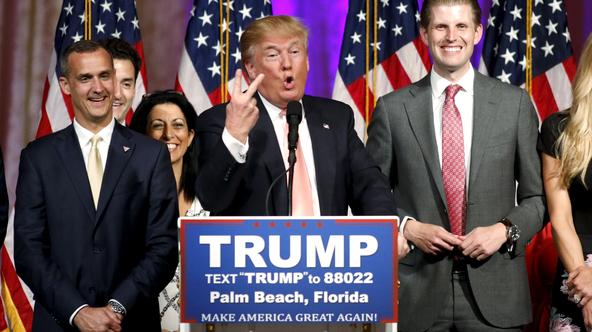 Republican U.S. presidential candidate Donald Trump stands between his campaign manager Corey Lewandowski (L) and his son Eric (R) as he speaks about the results of the Florida, Ohio, North Carolina, Illinois and Missouri primary elections during a news c