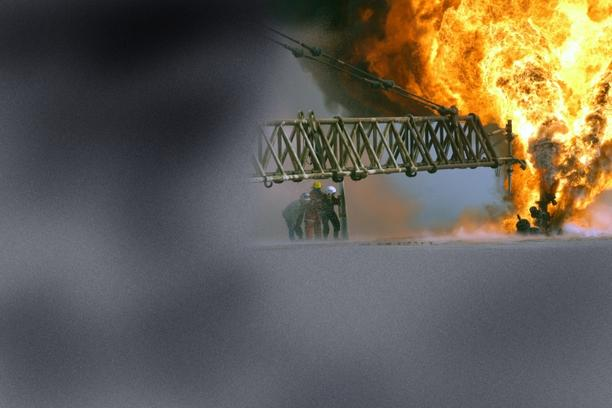 \'030328-M-0000X-005 Southern Iraq (Mar. 27, 2003) -- Kuwaiti firefighters fight an oil blaze at the Rumaila Oilfield as part of their ongoing support of Operation Iraqi Freedom, the multi-national co