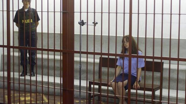 'U.S citizen Lori Berenson, jailed in Peru on terrorism charges, is seen behind bars in a concrete cell in Lima in this March 22, 2001 file photo. A Peruvian court granted parole on May 25, 2010 to Be