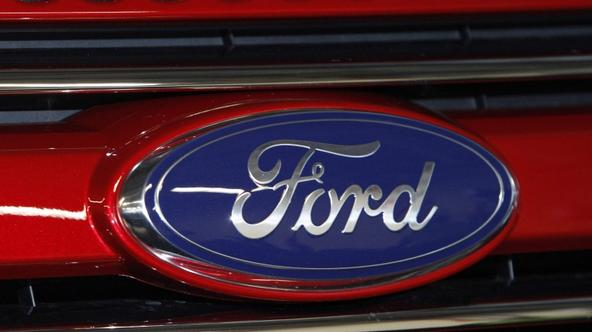\'A Ford logo is seen on a 2011 Ford Explorer at the Ford assembly plant in Chicago, Illinois, December 1, 2010. Ford Motor Co said its U.S. sales rose 24 percent in November from a year earlier amid