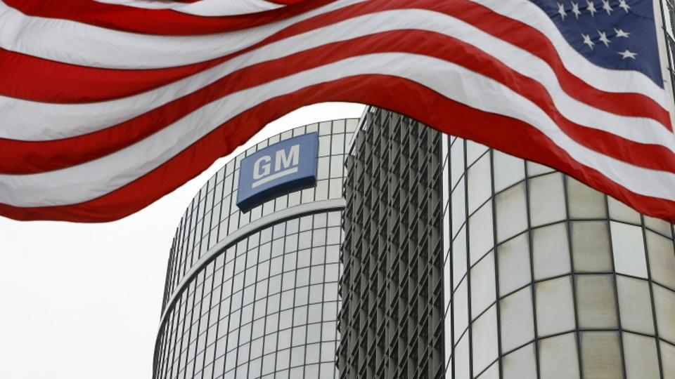 'An American flag flies in front of the General Motors, Global Headquarters in Detroit, Michigan, Monday, June 1, 2009. General Motors Corp. filed for Chapter 11 bankruptcy protection Monday as the ic