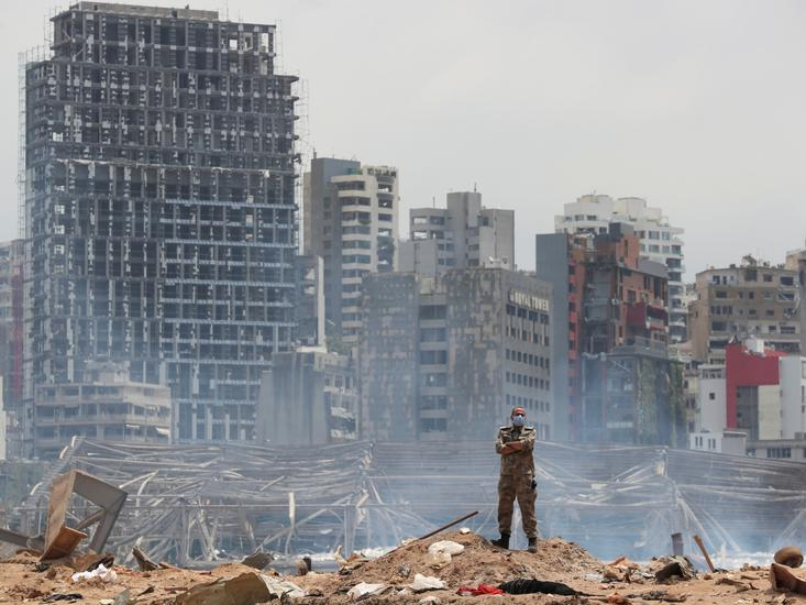A soldier stands at the devastated site of the explosion at the port of Beirut