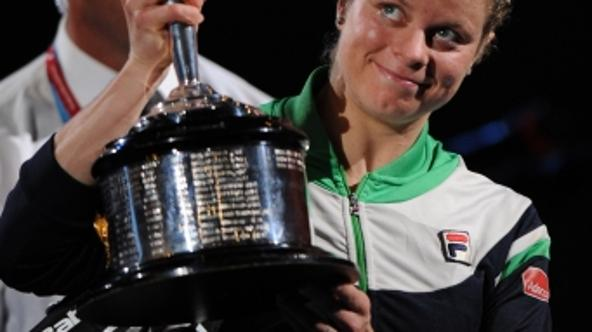 \'Kim Clijsters of Belgium poses with the winner\'s trophy after beating runner-up Li Na of China in the women\'s singles final on the thirteenth day of the Australian Open tennis tournament in Melbou