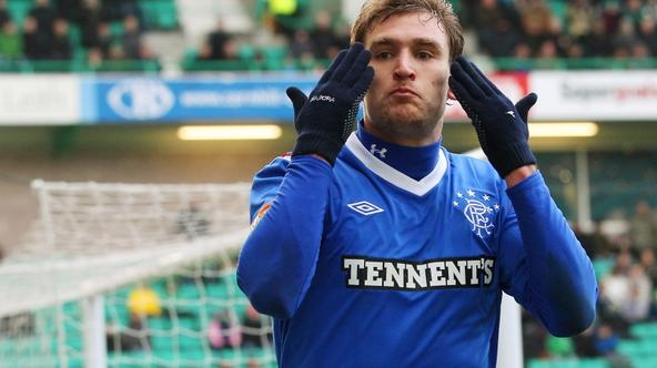 \'Rangers\' Nikica Jelavic celebrates scoring his second goal against Hibernian during their Scottish Premier League soccer match in Edinburgh, Scotland December 10, 2011. REUTERS/David Moir (BRITAIN