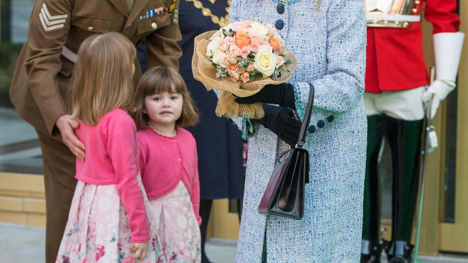 Queen reopens the National Army Museum Queen Elizabeth II smiles after she was presented with a posy of flowers by a child as she leaves after officially reopening the National Army Museum at the Royal Hospital Road, Chelsea. Dominic Lipinski  Photo: Pres