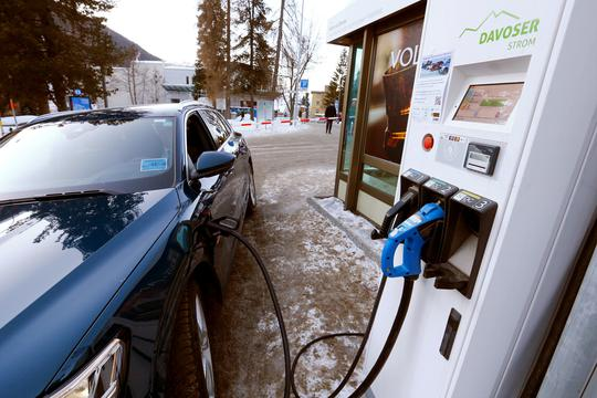FILE PHOTO: An electric-powered Audi car is charged at a charging station in Davos