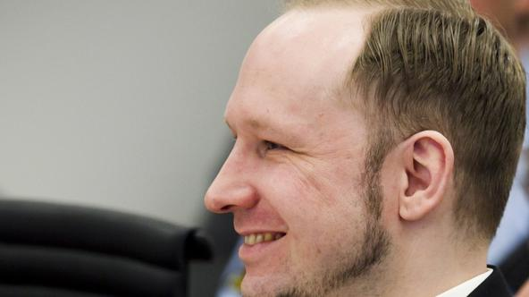 'Norwegian mass killer Anders Behring Breivik smiles during the second day of his terrorism and murder trial in Oslo April 17, 2012. Breivik, who massacred 77 people last summer, took to the stand for