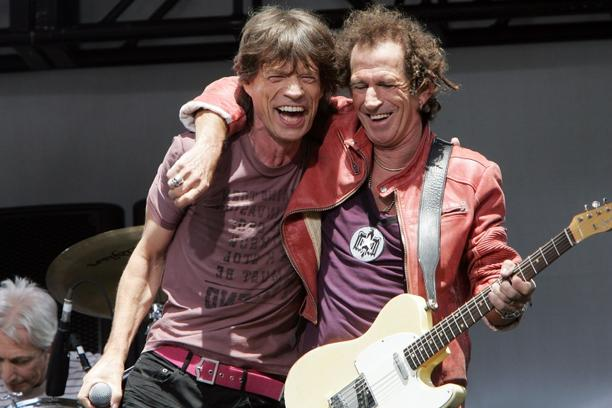 \'NEW YORK - MAY 10:  Mick Jagger (L) and Keith Richards of The Rolling Stones perform onstage to announce a world tour at the Julliard Music School May 10, 2005 in New York City.  (Photo by Scott Gri
