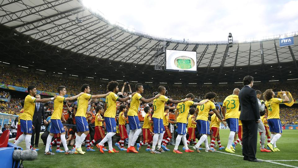 Football - Brazil v Germany - FIFA World Cup Brazil 2014 - Semi Final - Estadio Mineirao, Belo Horizonte, Brazil - 8/7/14 Brazil enter the pitch before the game Mandatory Credit: Action Images / Andrew Couldridge  EDITORIAL USE ONLY.