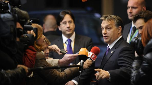 'Hungarian Prime Minister Viktor Orban (R) talks to the press as he arrives at the EU Headquarters on November 22, 2012 in Brussels, to take part in a two-day European Union leaders summit called to a