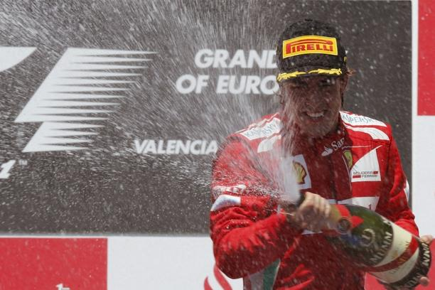 'Ferrari Formula One driver Fernando Alonso of Spain sprays champagne during the podium ceremony after the European F1 Grand Prix at the Valencia street circuit June 24, 2012. Alonso won the European