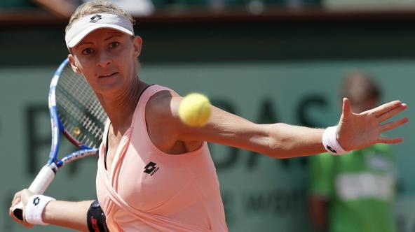 'Croatia\'s Mirjana Lucic returns the ball to Russia\'s Maria Sharapova during their Women\'s first round match in the French Open tennis championship at the Roland Garros stadium, on May 24, 2011, in