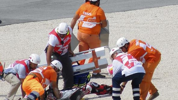 'Suter Moto2 rider Shoya Tomizawa of Japan is carried on a stretcher following a crash during the San Marino motorcycling Grand Prix at the Misano circuit September 5, 2010. Tomizawa died after suffer