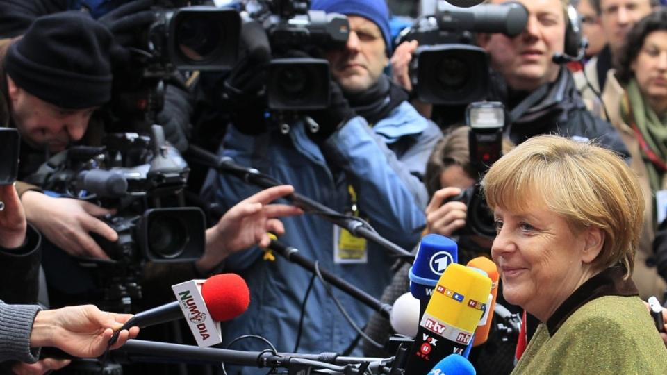 'Germany's Chancellor Angela Merkel arrives at the EU council headquarters for an European Union leaders summit meeting to discuss the European Union's long-term budget in Brussels February 7, 2013.