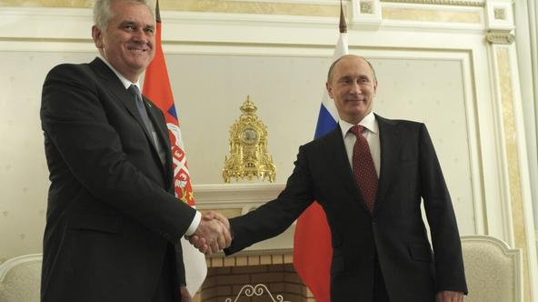 'Russian President Vladimir Putin (R) shakes hands with his Serbian counterpart Tomislav Nikolic during a meeting at the Bocharov Ruchei state residence in Sochi, September 11, 2012.  REUTERS/Alexsey