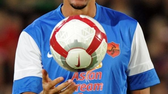 'England football veteran defender, Rio Ferdinand smiles while playing with a ball during the football charity match in the Asian Dream Cup 2012 in Bangkok on May 23, 2012.  Park Ji-Sung, the founder