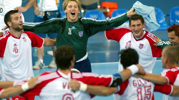 Croatia's men's handball team, including from L-R, Ivano Balic, Venio Losert, and Mirza Dzomba form a circle with team mates as they celebrate their quarter-finals win against Greece at the Athens 2004 Olympic Games August 24, 2004. Croatia defeated Greec