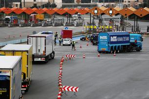 Border police prepare to inspect trucks at the last toll gate entering Spain from France, following an order from the Spanish government to set up controls at its land borders over coronavirus, in La Jonquera