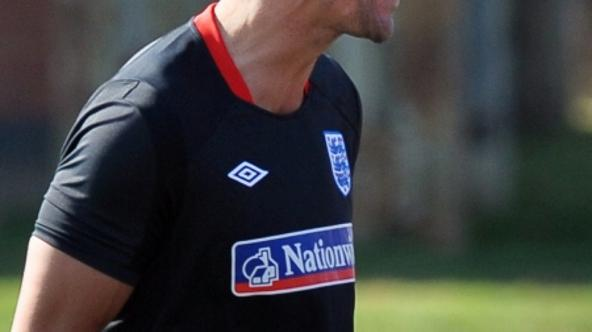 \'England\'s Rio Ferdinand laughs during a training session at the Royal Bafokeng Sports Campus near Rustenburg on June 4, 2010, ahead of their opening game against USA on June 12. England skipper Rio