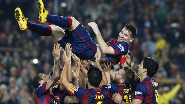 ATTENTION EDITORS - REUTERS PICTURE HIGHLIGHT TRANSMITTED BY 2125 GMT ON NOVEMBER 22, 2014   BAR11R Barcelona's Lionel Messi celebrates his second goal with teammates during their Spanish first division soccer match against Sevilla at Nou Camp stadium in