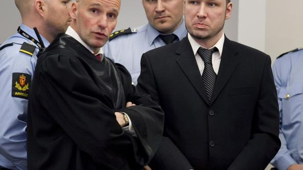 'Defendant Anders Behring Breivik (R) is seen with his lawyer Geir Lippestad during the third day of proceedings in the courthouse in Oslo April 18, 2012.  REUTERS/Heiko Junge/Scanpix Norway/Pool (NOR