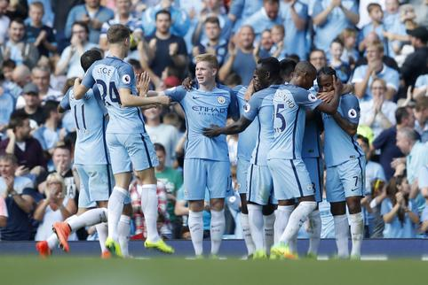 Football Soccer Britain - Manchester City v AFC Bournemouth - Premier League - Etihad Stadium - 17/9/16 Manchester City's Ilkay Gundogan celebrates scoring their fourth goal with team mates Action Images via Reuters / Carl Recine Livepic EDITORIAL USE ONL