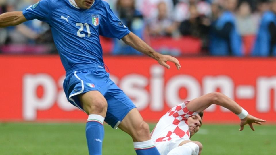'Italian midfielder Andrea Pirlo (L) vies with Croatian midfielder Ivan Perisic during the Euro 2012 championships football match Italy vs Croatia on June 14, 2012 at the Municipal Stadium in Poznan.
