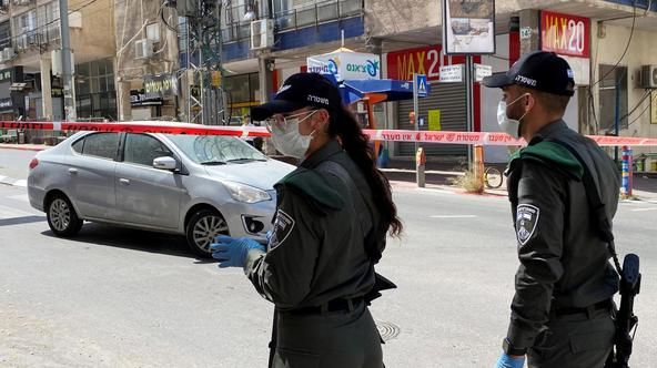 Israeli police stand guard at the entrance to the town of Bnei Brak as they enforce a lockdown of the ultra-Orthodox Jewish town badly affected by coronavirus disease (COVID-19), Bnei Brak