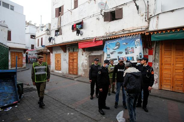 FILE PHOTO: Police officers patrol streets in the old Medina in Casablanca